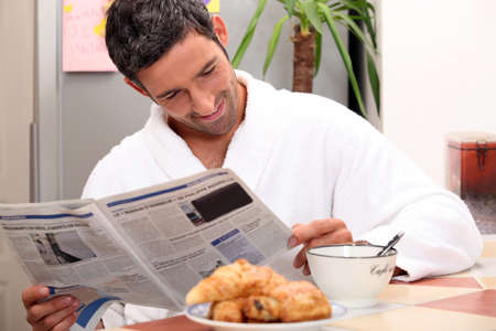 everyday people: Man at kitchen table having breakfast Stock Photo