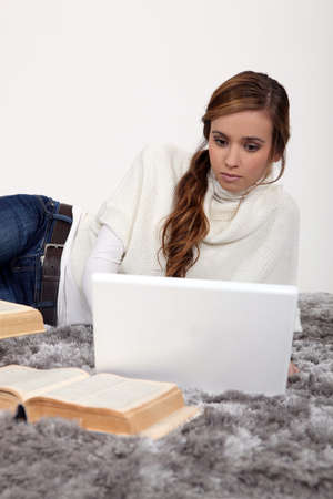 Young woman working on a university assignment Stock Photo - 15815133
