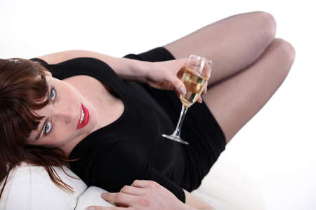 Woman drinking champagne alone photo