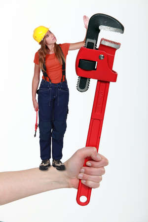Composite of a woman with an adjustable wrench photo