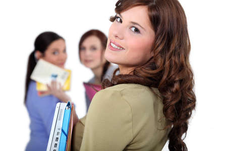 looking after: Young woman meeting up with her friends at school Stock Photo