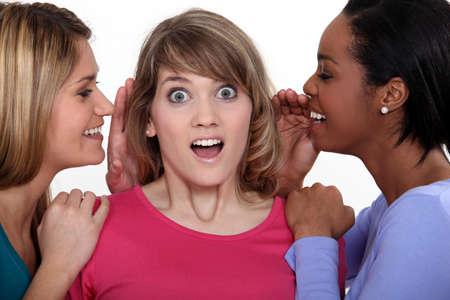 strangeness: Girls gossiping Stock Photo