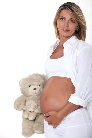love toys: Pregnant woman with teddy bear