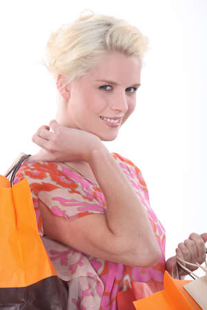 Closeup of a woman with storebags photo