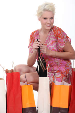 blonde woman and many carton bags photo