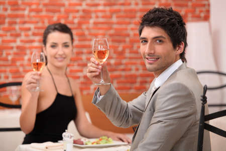 Couple having a meal in a fancy restaurant photo