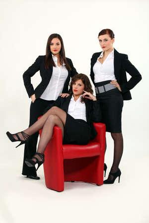 sexy legs stockings: Trio of sexy businesswomen Stock Photo