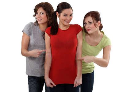 boastful: Women showing off their friend Stock Photo