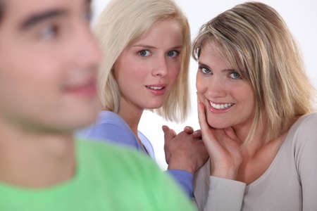 blab: Tow girls gossiping about boy Stock Photo