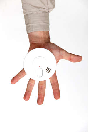 Man holding smoke alarm photo