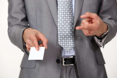 Man pointing at business card Stock Photo - 15796516