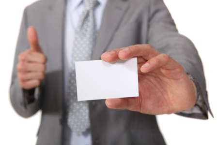 Executive with a blank businesscard Stock Photo - 15796513
