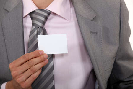 Executive holding a blank business card Stock Photo - 15817737