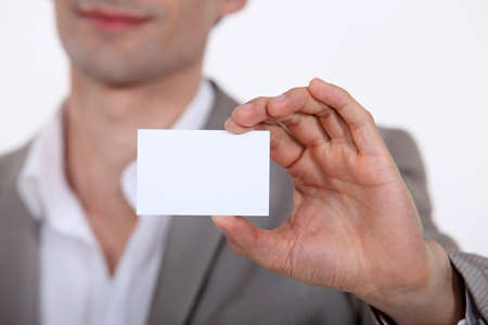 Close-up of businessman with card Stock Photo - 15795941