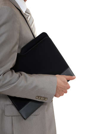 A cropped picture of a businessman carrying a folder  photo