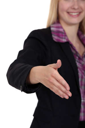 Woman holding her hand out for a handshake photo