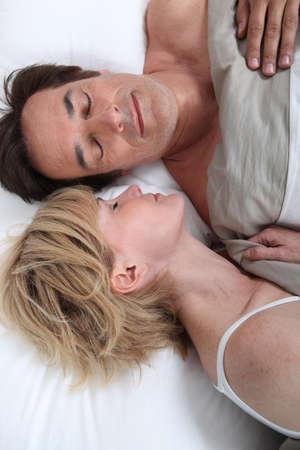 2 50: Husband and wife sleeping Stock Photo