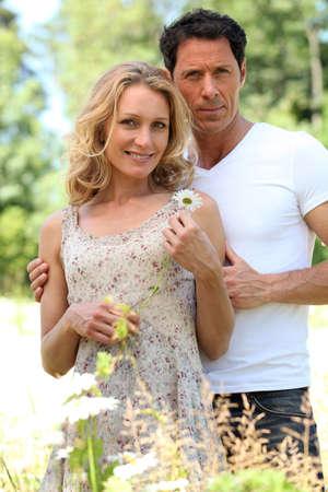 man 40 50: Husband with arm around wife