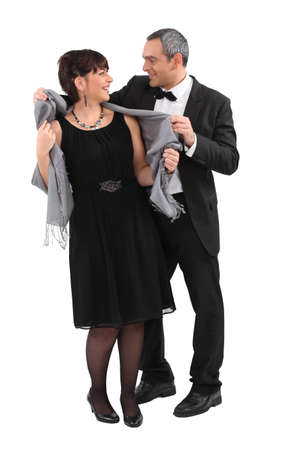 40s adult: Couple leaving for an evening event