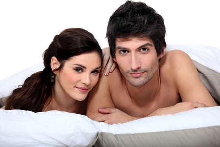 male torso: Couple in bed