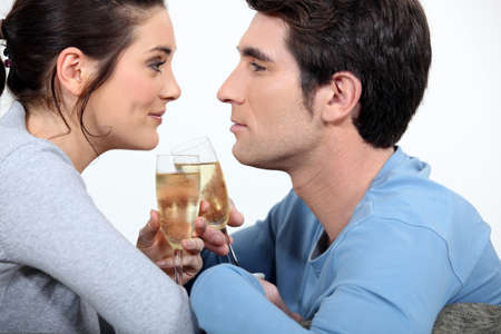 adore: Couple having a glass of champagne