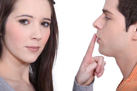 Woman putting her finger on a man Stock Photo - 15799378