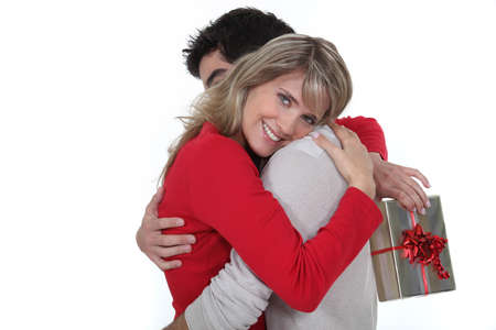 you are special: husband giving her wife a present Stock Photo