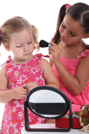grown ups: Two little girls playing with make-up Stock Photo