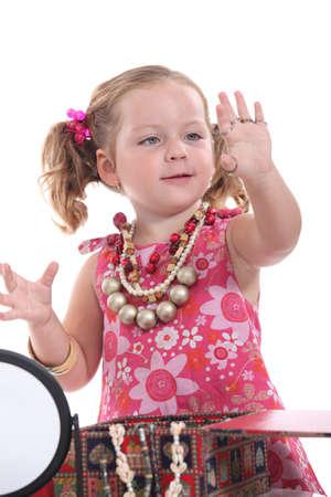 Girl putting on jewellery photo