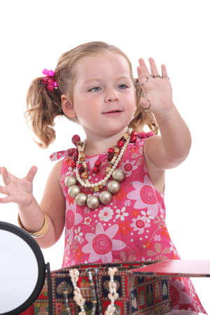girl with rings: Girl putting on jewellery Stock Photo