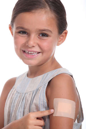 patches: A girl wearing an adhesive bandage Stock Photo