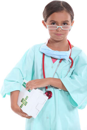 Girl dressed as a doctor photo