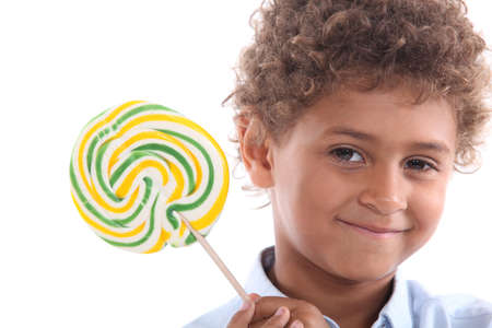 Little boy holding lollipop Stock Photo - 15796895