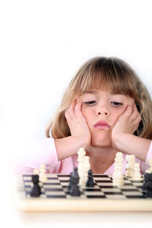 Girl playing chess photo
