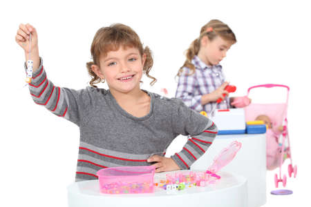 make belief: Girls playing with their toys Stock Photo