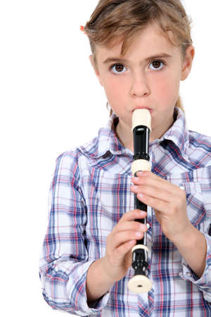 Little girl playing a recorder photo