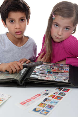 stamp collecting: Two young children stamp collecting
