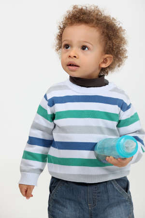 fro: Cute toddler holding a bottle