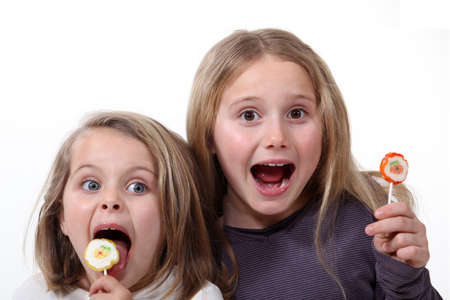 8 9: Little girls with lollipops Stock Photo