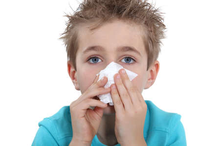 Young boy blowing his nose Stock Photo - 15807611