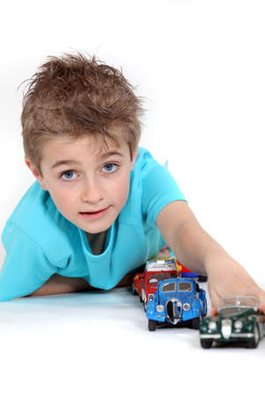 5 10 years old: Little boy playing with toy cars Stock Photo