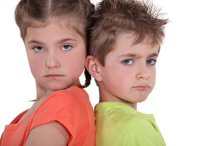 brother sister fight: Children having a disagreement Stock Photo