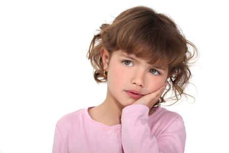 Young girl looking worried photo