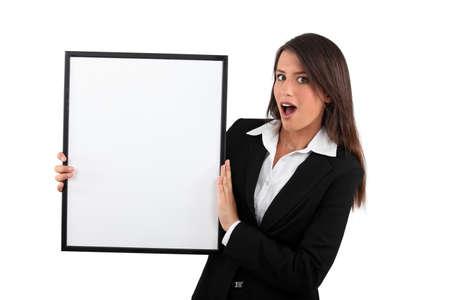 dark haired: portrait of a saleswoman