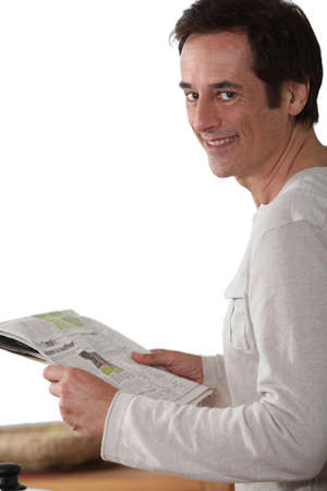 Man happy reading newspaper  Stock Photo - 15807553