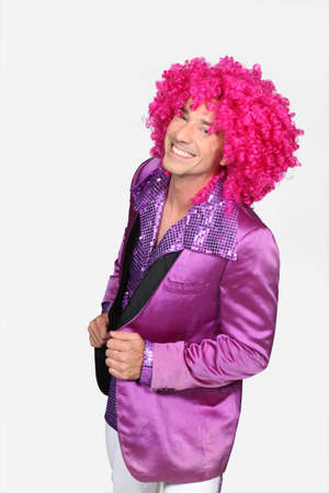 man in disco costume photo
