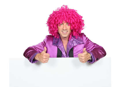 disguised: Man with a pink wig Stock Photo