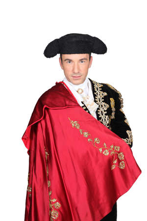 historical clothing: Man in a matador costume with a red cape Stock Photo