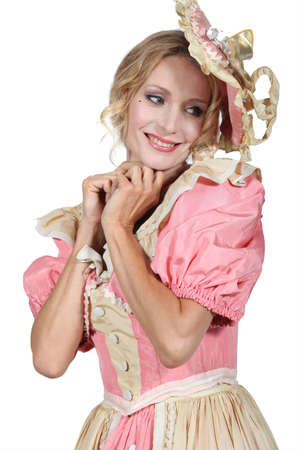 bonnet up: Woman in a pink costume Stock Photo