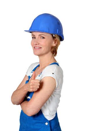 evoking: Female builder Stock Photo